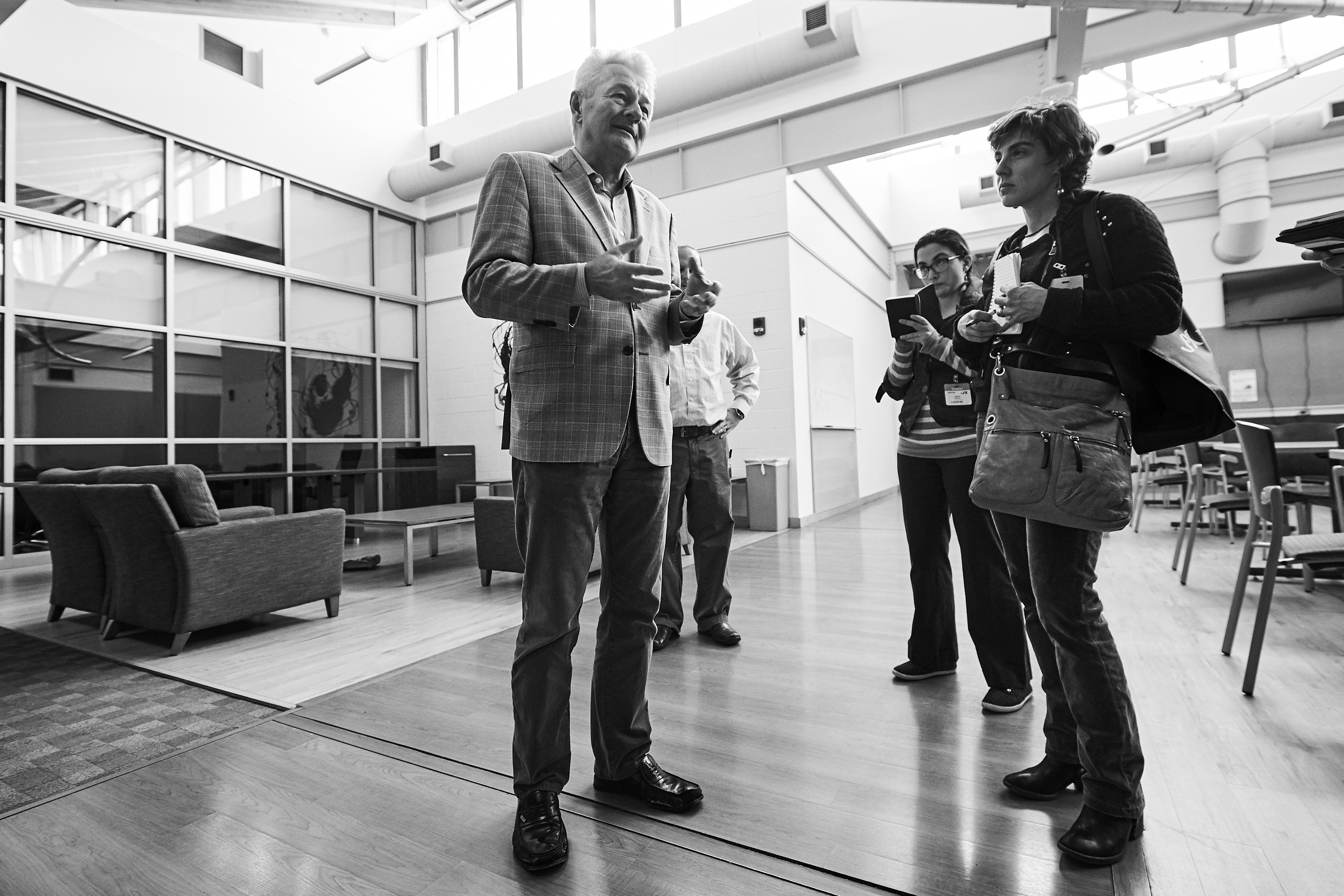 Reinhard Laubenbacher, professor of cell biology, speaks with journalists at the Cell and Genome Sciences Building in Farmington on March 15, 2016. (Peter Morenus/UConn Photo)