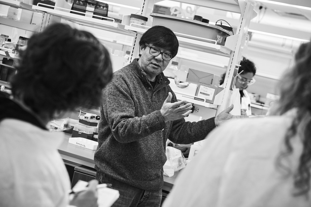 Yijun Ruan, professor and director of genomic sciences, speaks with journalists visiting his lab at The Jackson Laboratory at UConn Health in Farmington on March 15, 2016. (Peter Morenus/UConn Photo)
