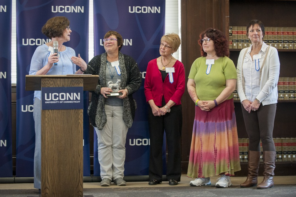 Left to right, Pat Moriarty, Valerie Kiefer, Cindy Walsh, Hilarie Jones, Melanie Kraus, and Virginia Shea (not pictured), of Student Health Services Sexual Assault Team received the Team Award at the UConn Spirit Awards ceremony on March 8, 2016. (Sean Flynn/UConn Photo)