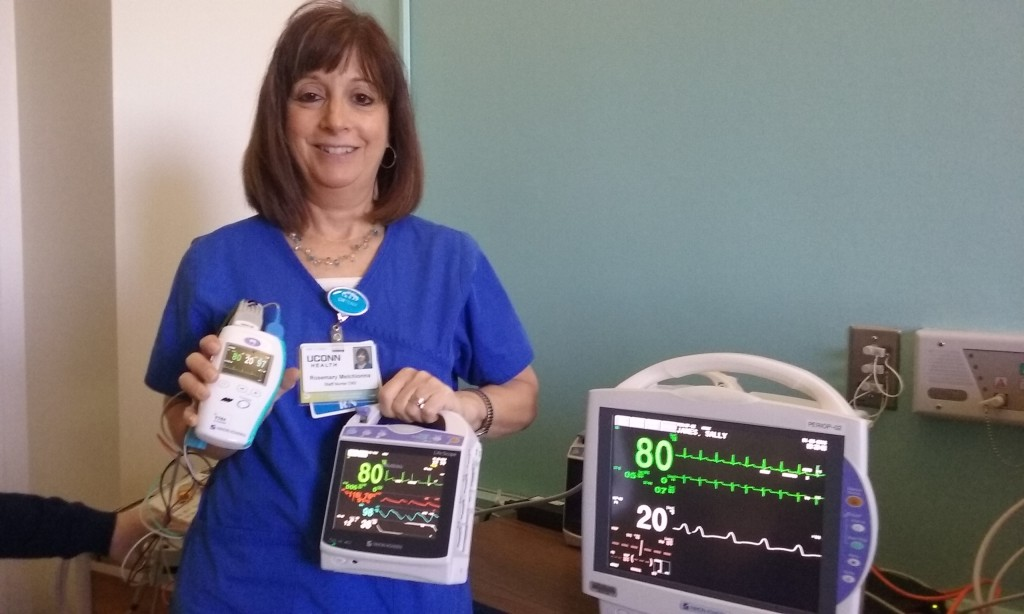 Rosemary Melchionna, a nurse in the post-anesthesia care unit, shows the updated central monitoring technology.