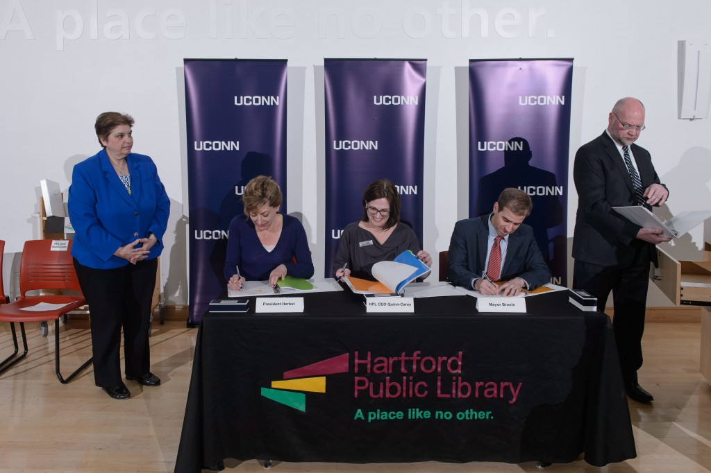 A ceremony held on April 21, 2016 at the Hartford Public Library to sign an agreement to host the new downtown UConn Hartford library there. From left are HPL CAO Mary Tzambazakis, President Susan Herbst, HPL CEO Bridget Quinn-Carey, Mayor Luke Bronin and UConn attorney Robert Sitkowski. (Peter Morenus/UConn Photo)