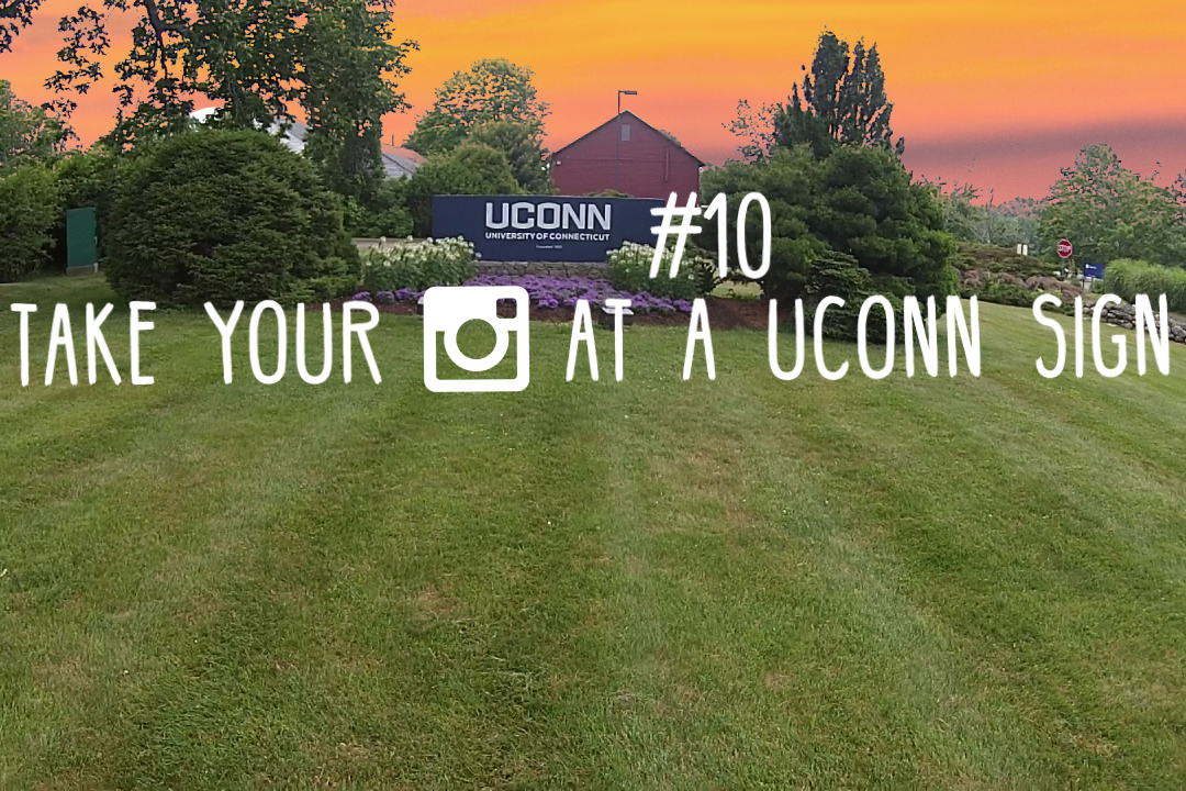 The #UConnbucketlist item for May: Take Your Photo at a UConn Sign. (Elizabeth Caron/UConn Photo)