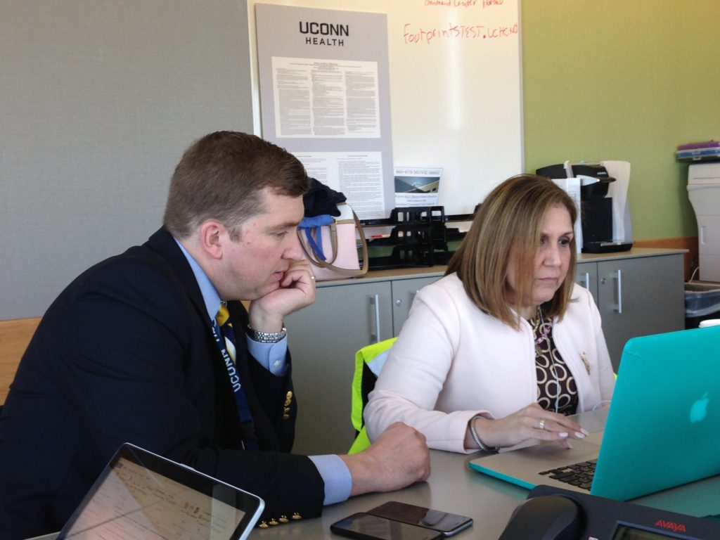 Anne Diamond, CEO of UConn John Dempsey Hospital, right, with Kevin Larsen, associate vice president for business and ancillary services for UConn John Dempsey Hospital, in the Incident Command Center on May 11.