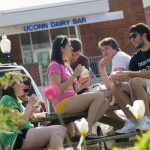 Students eating ice cream outside the UConn Dairy Bar.