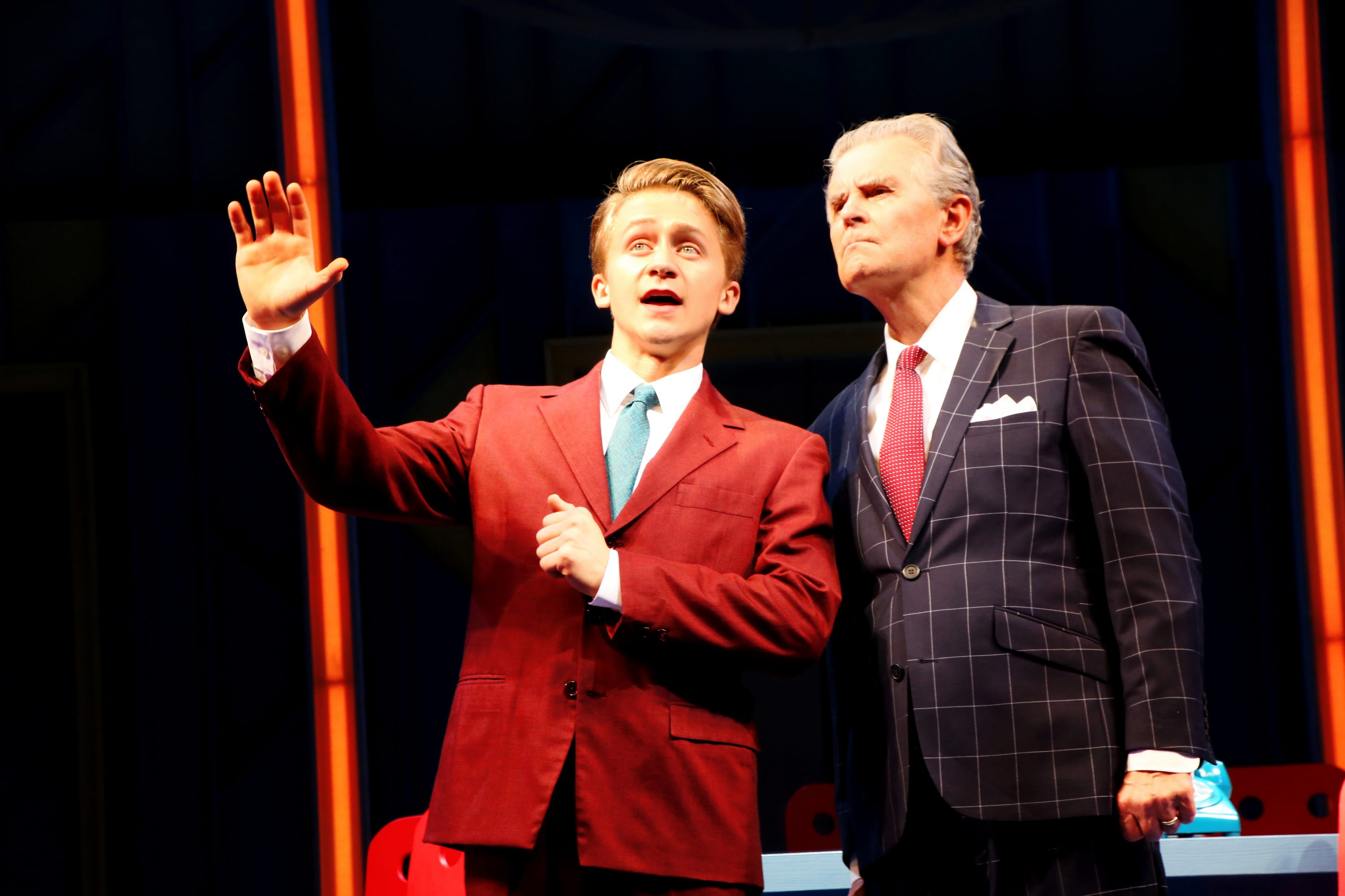 Riley Costello (Finch), left, and Fred Grandy (Biggley) in 'How to Succeed in Business Without Really Trying,' onstage June 2-12, 2016 at Connecticut Repertory Theatre's Harriet S. Jorgensen Theatre. (Gerry Goodstein for UConn)