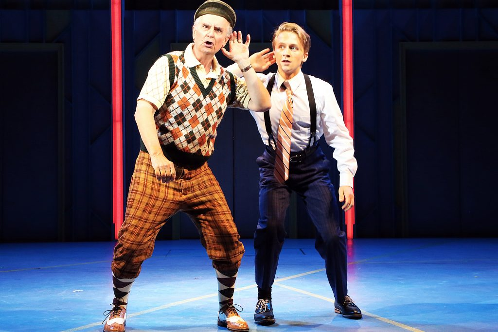 Fred Grandy (Biggley), left, and Riley Costello (Finch) in 'How to Succeed in Business Without Really Trying,' onstage June 2-12, 2016 at Connecticut Repertory Theatre's Harriet S. Jorgensen Theatre. (Gerry Goodstein for UConn)