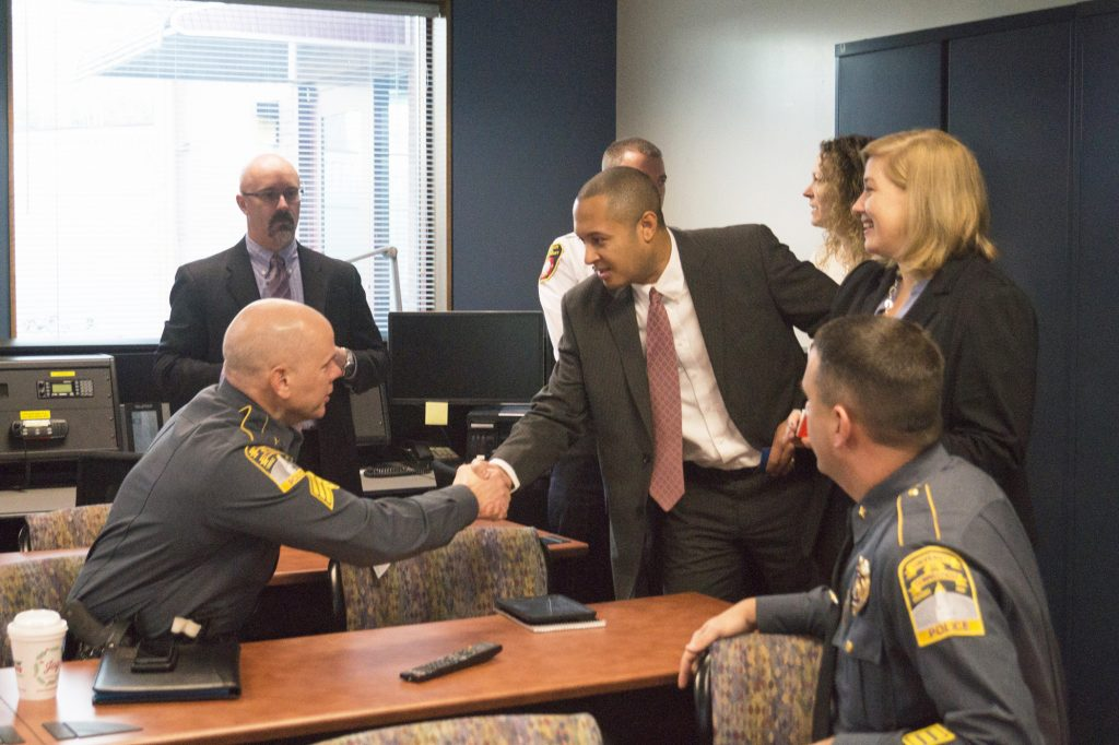 Alumnus Robert Hotaling '01 (ENG) meets with members of the UConn Police. (UConn Foundation Photo)