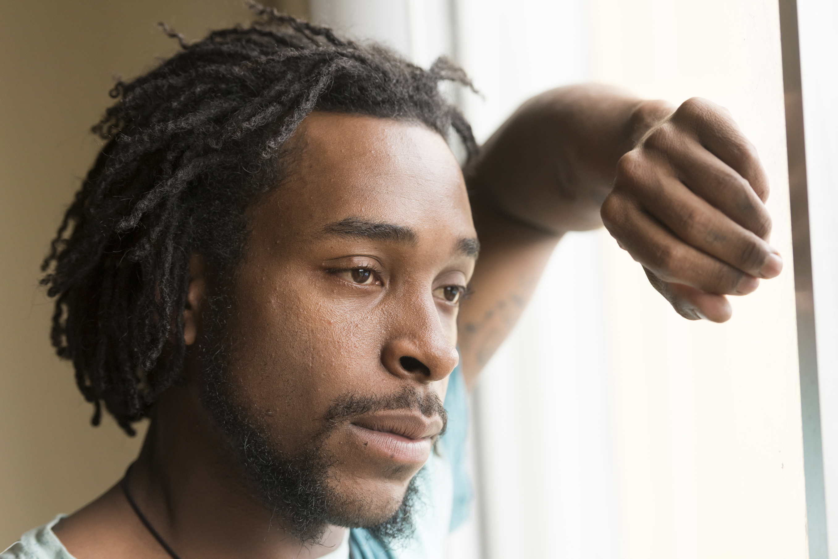 African American man looking through a window. (iStock Photo)