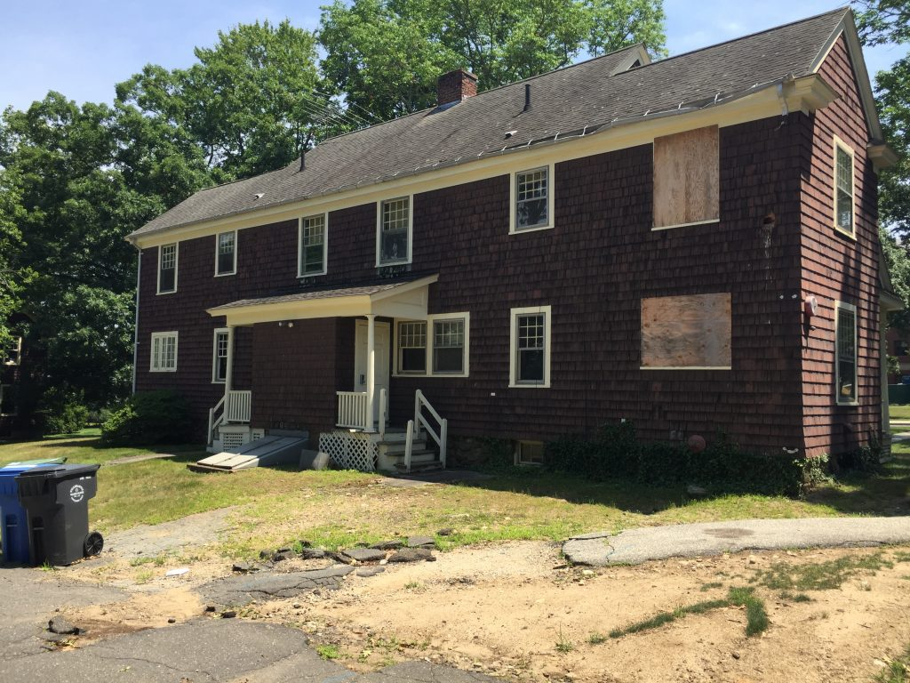 The houses on 'Faculty Row,' also known as 'Greek Row,' are in a state of disrepair. (UConn Photo)