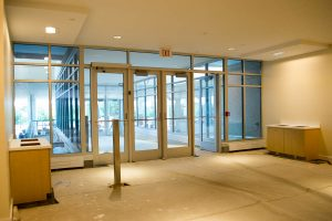 The renovated academic entrance features a new vestibule with a gentle ramp, eliminating the need for stairs on the way into the atrium. (Tina Encarnacion/UConn Health)