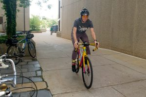 Josh Mills, who normally bikes straight to Munson Road from New Hartford daily, takes a detour to the July bike to work breakfast table. (Photo by Tina Encarnacion)