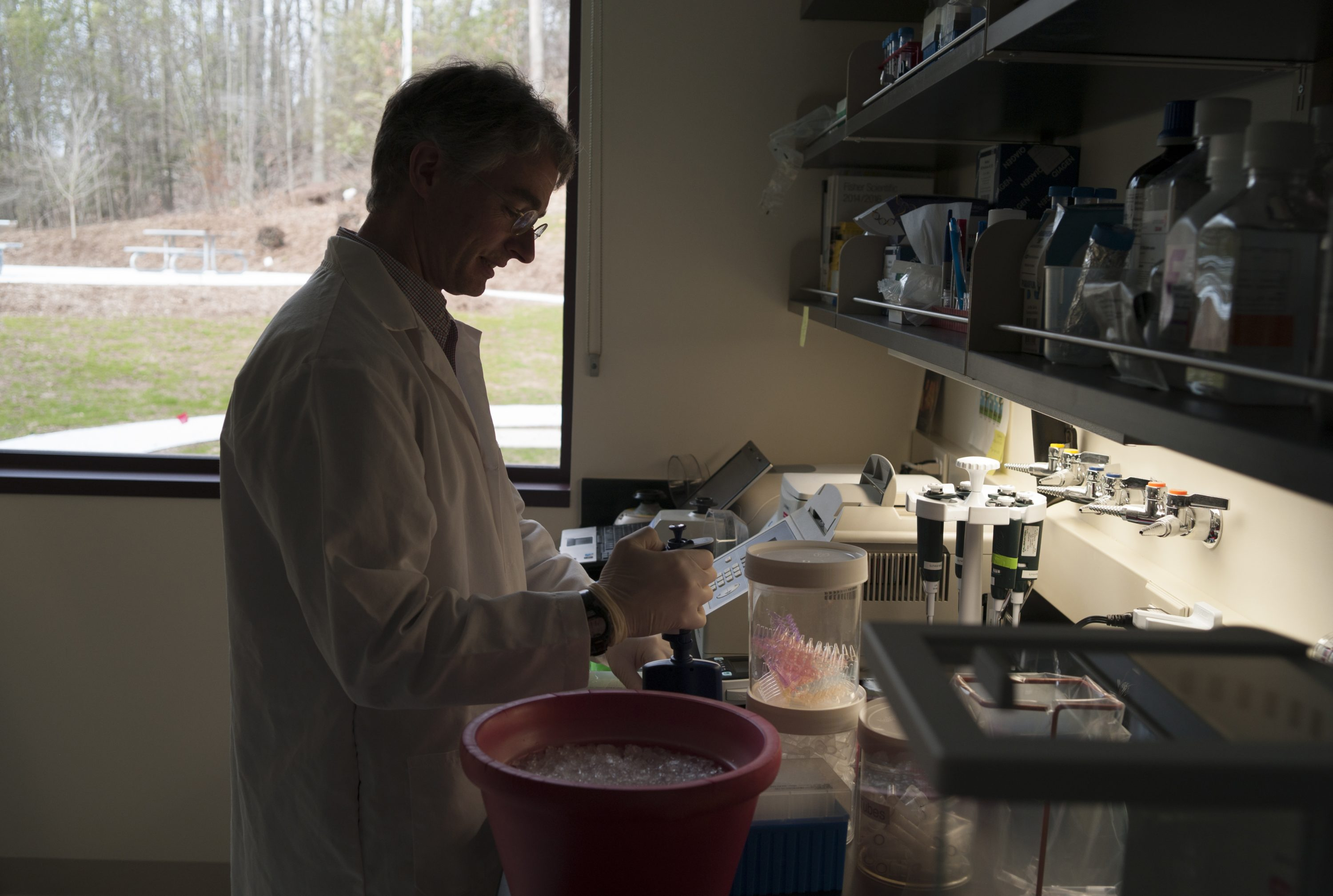 Mark Driscoll, co-founder of Shoreline Biome, at work in a lab at the UConn technology incubator in Farmington on March 31, 2016. (Peter Morenus/UConn Photo)
