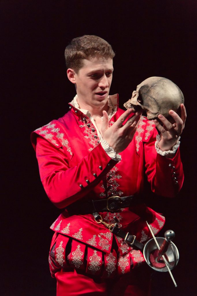 "Zach Appleman as Hamlet in the Hartford Stage production of ""Hamlet."" The costume is part of the exhibition"" ""First Folio! The book That Gave Us Shakespeare"" at the Benton Museum of Art. (T. Charles Erickson Photo)"