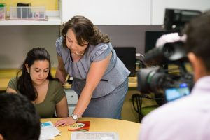 Fany D. Hannon '08 MA, center, director of the Puerto Rican/Latin American Cultural Center speaks with Natalia Gutierrez '18 (ENG) while being recorded by Juan Carlos Sanchez of Univision at PRLACC on Aug. 12, 2016. (Peter Morenus/UConn Photo)