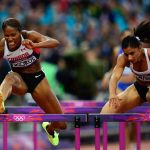 UConn alumna and Canadanian Phylicia George (left) competes in the women's 100-metre hurdle semifinals at the Olympic Stadium during the Summer Olympics in London in 2012. (THE CANADIAN PRESS/Sean Kilpatrick)
