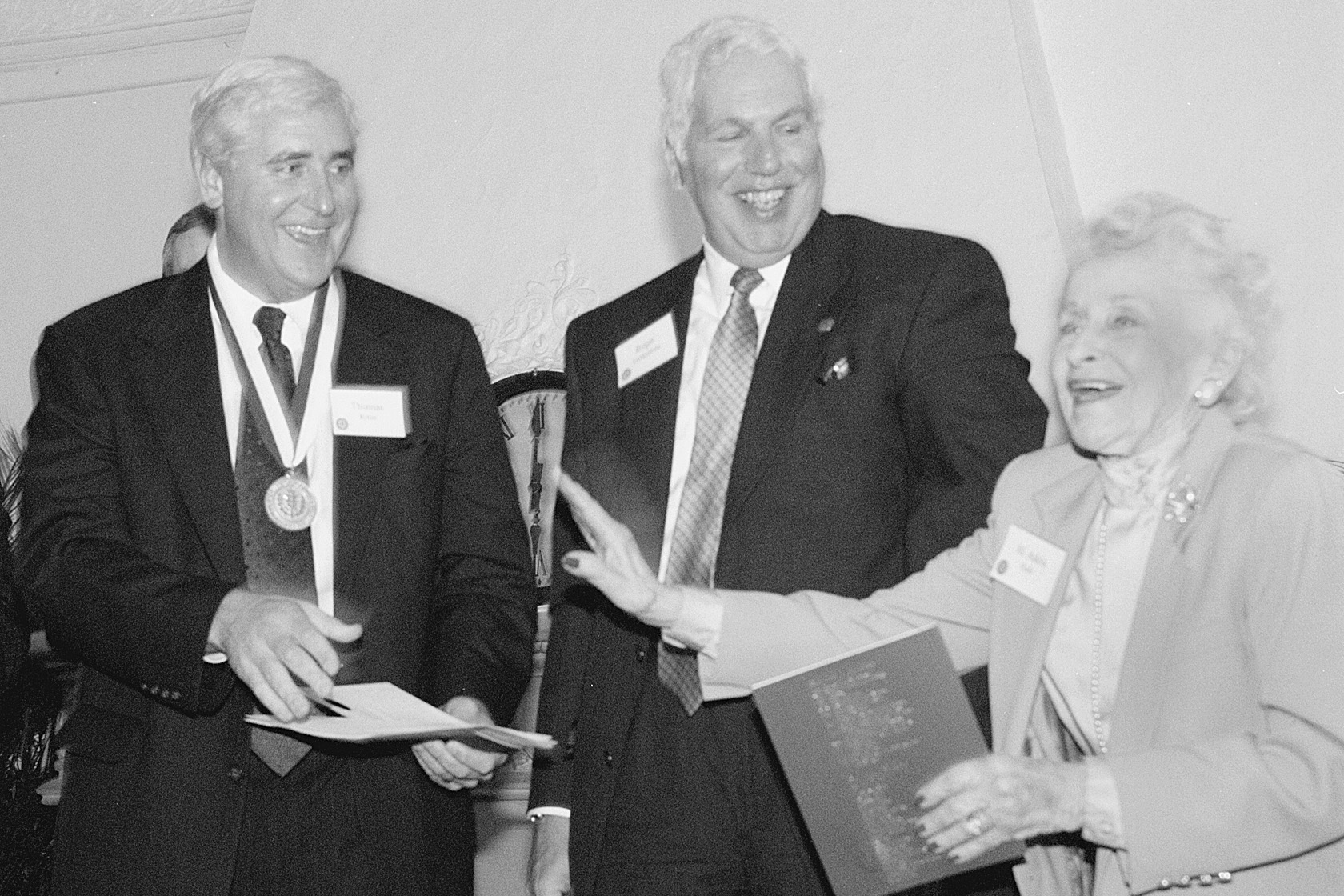 Thomas Ritter, recipient of UConn's highest honor, the University Medal, shares a joke with Roger A. Gelfenbien, chair of the Board of Trustees, and M. Adela Eads, Senate Minority Leader, at a reception at the School of Law in 1999. (Peter Morenus/UConn File Photo)
