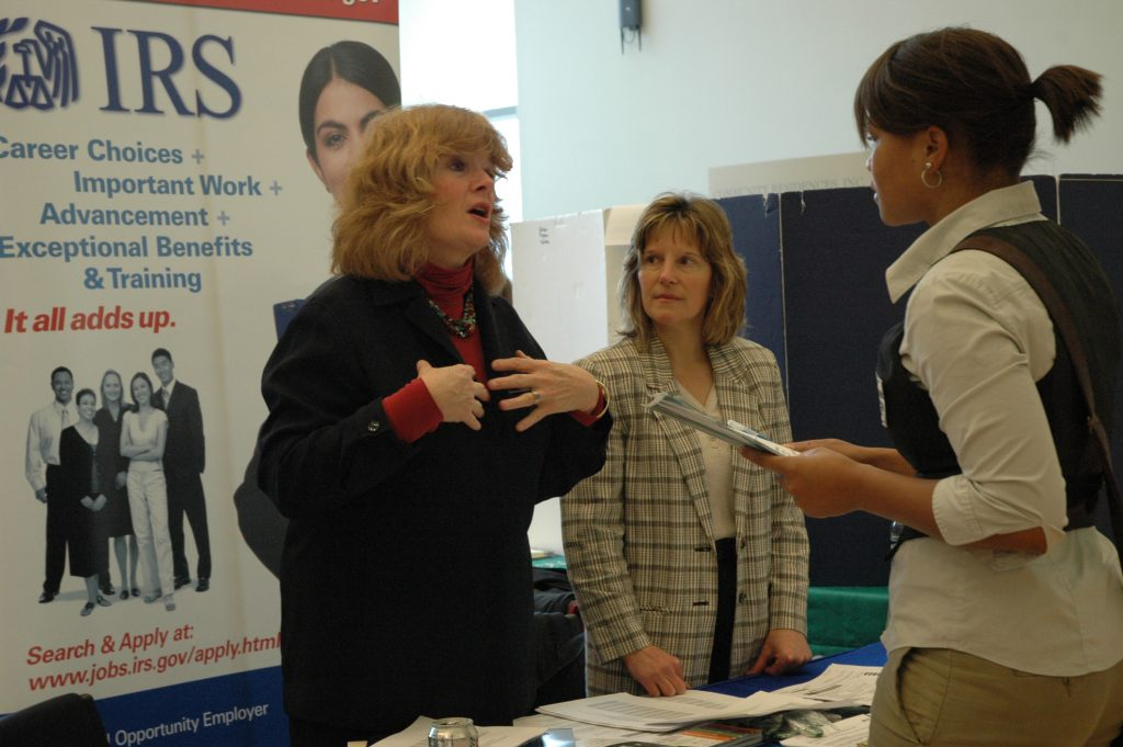 Maryann Colburn, left, from the Internal Revenue Service, speaks with Falak Campbell '10 (CLAS), a psychology major, at the Careers for the Common Good Fair. (UConn File Photo)
