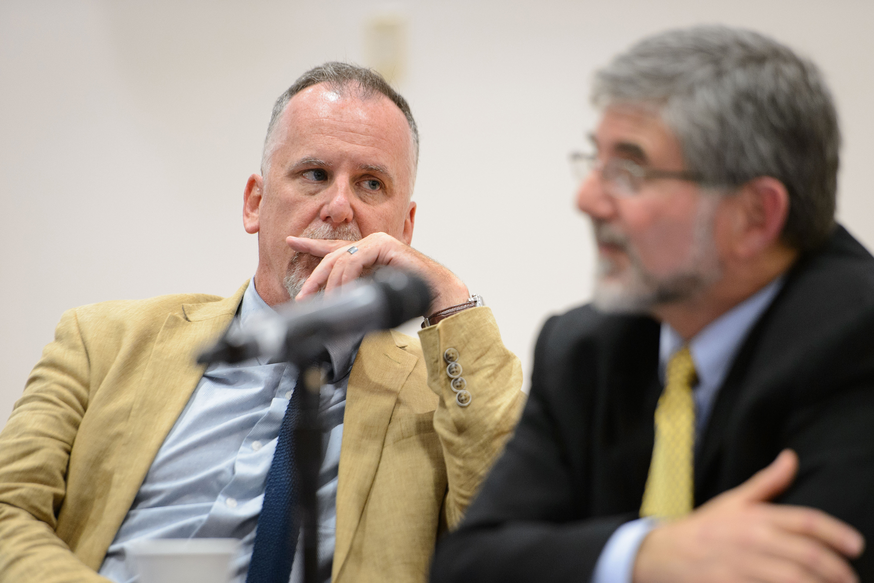 Michael Patrick Lynch, professor of philosophy and director of the UConn Humanities Institute, left, listens while Paul Herrnson, professor of political science, answers a question during a panel discussion on the presidential election at an event held at the Hartford Public Library on Sept. 22, 2016. (Peter Morenus/UConn Photo)