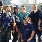 Members of the UConn Health Special Operations Unit traveled to New York City in a specially equipped vehicle and were assigned to provide medical support for the New York Urban Search and Rescue Team. They are from left to right: William Perkins, Carmine Centrella, John Kowalski, Robert Fuller, M.D., Greg Priest, Ben Sonstrom, and, kneeling, Daryl Byrne. Fuller is chief of emergency medicine for the Health Center and medical director of the group. The others are all paramedics with the special tactical training.