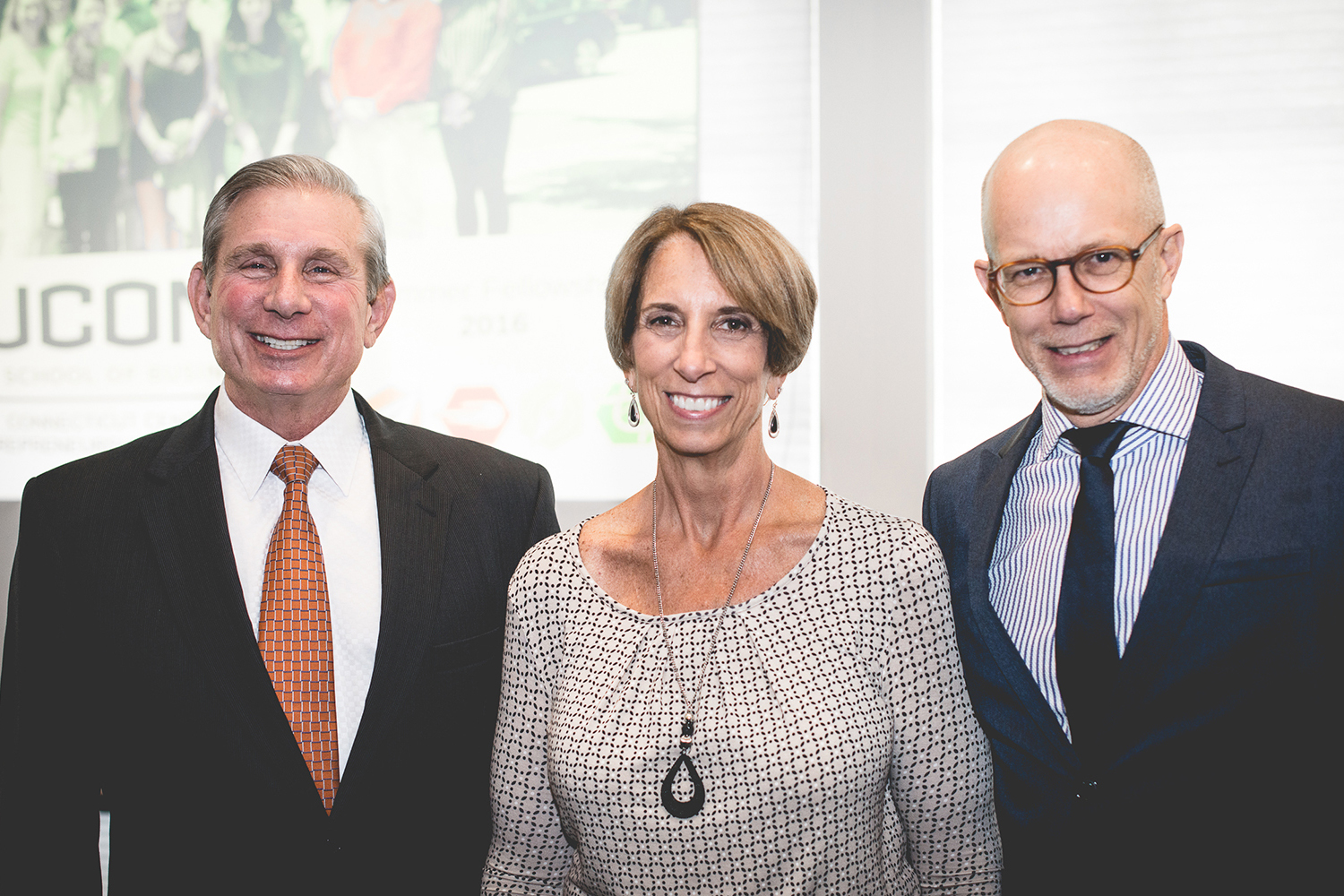 Greg Wolff, Deb (Wolff) Davis, and Professor Timothy B. Folta (Nathan Oldham/UConn photo)