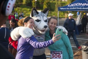 Left to right, Dylan Beaton and Darby Muia pose with Jonathan before running in the Huskies Forever 5k on Sunday morning.  Oct. 16, 2016. (Garrett Spahn/UConn Photo)
