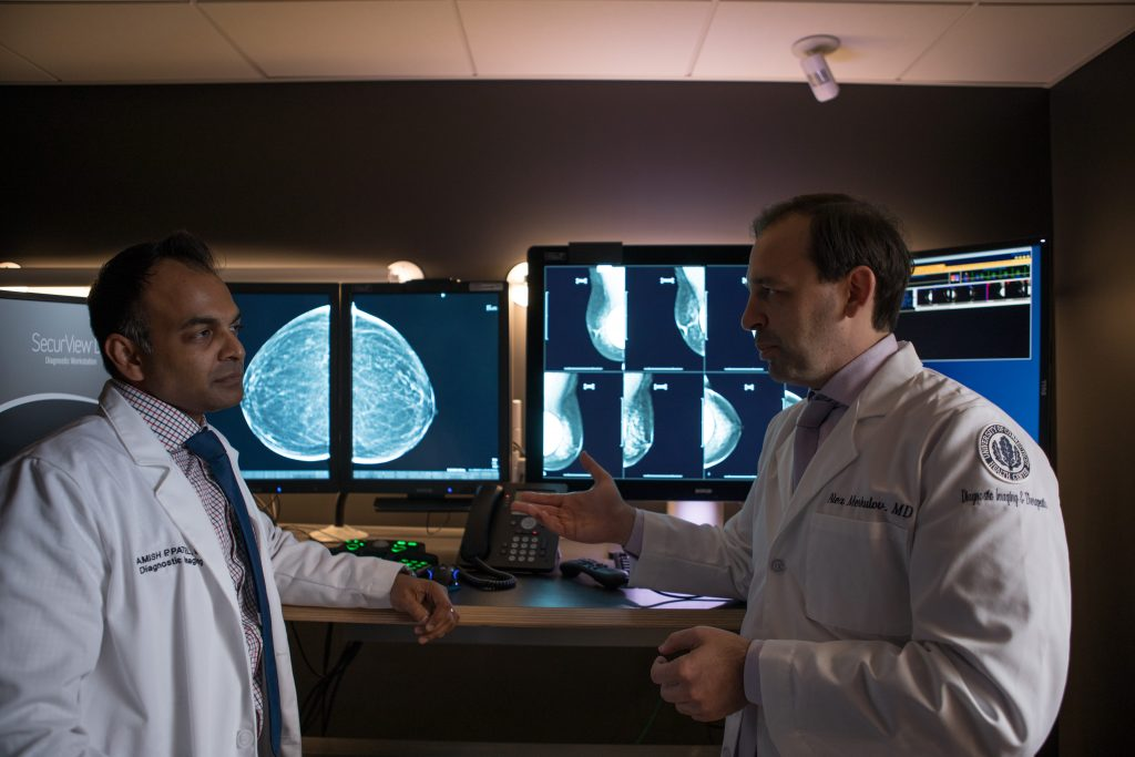 From left, radiologists Dr. Amish Patel and Dr. Alex Merkulov, head of women's imaging, in the Women's Center Imaging Suite at UConn Health. (Paul Horton for UConn)