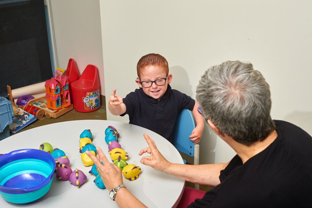 Marie Coppola tests children at the Bousfield Psychology Building. (Peter Morenus/UConn Photo)