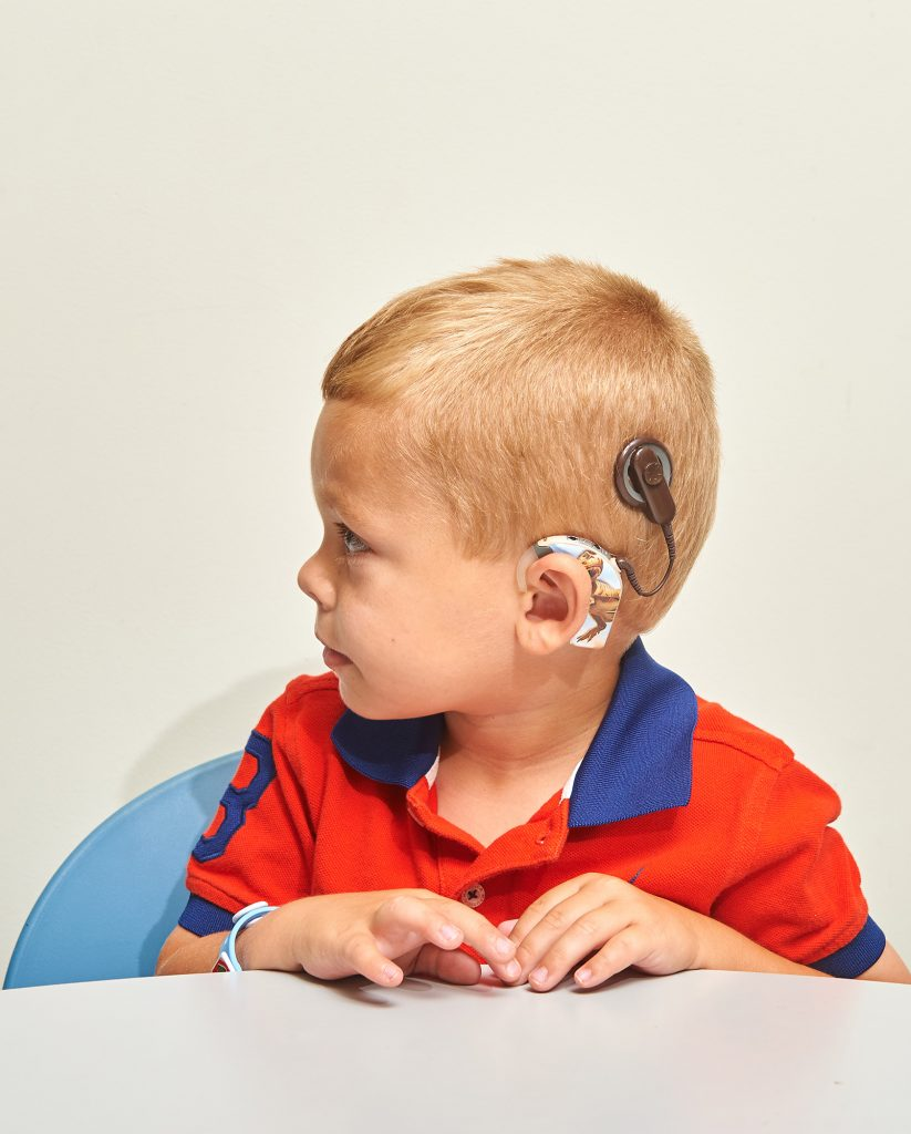 A child with a cochlear implant. (Peter Morenus/UConn Photo)