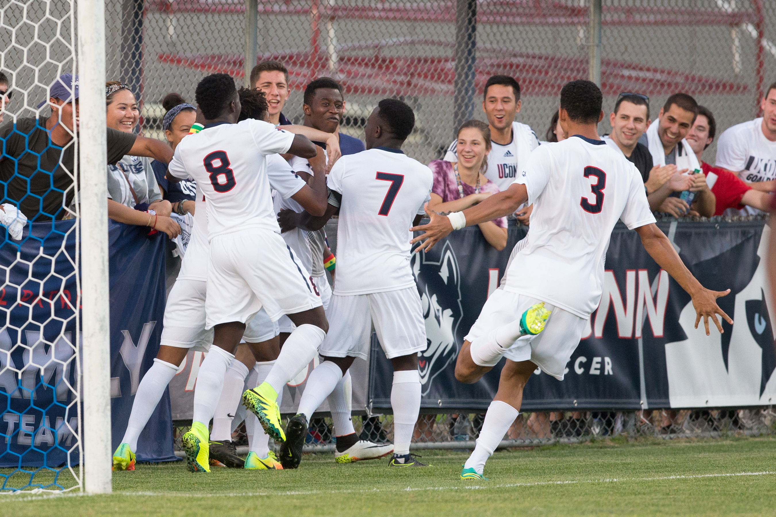 The Huskies celebrate their winning goal against Tulsa on Oct. 1. (Stephen Slade '89 (SFA) for UConn)