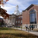 Students walk in front of the Wilbur Cross Building on the Storrs campus. (Bret Eckhardt/UConn Photo)