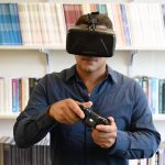 Assistant professor of communication John Christensen wearing a virtual reality headset. (UConn Photo)