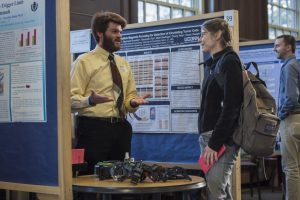 Gregory Bicknell '16 (ENG) discusses his research at the Fall Frontiers in Research Poster Exhibition in Wilbur Cross South Reading Room on Oct. 26, 2016. (Ryan Glista '16 (CLAS)/UConn Photo)