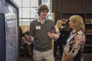 Ryan Thibodeau '17 (CLAS) discusses his research at the Fall Frontiers in Research Poster Exhibition in Wilbur Cross South Reading Room on Oct. 26, 2016. (Ryan Glista '16 (CLAS)/UConn Photo)