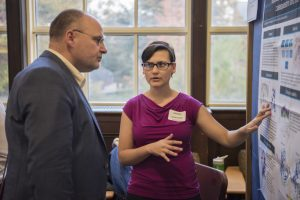 Gabriella Regianno '17 (CLAS) discusses her research at the Fall Frontiers in Research Poster Exhibition in Wilbur Cross South Reading Room on Oct. 26, 2016. (Ryan Glista '16 (CLAS)/UConn Photo)