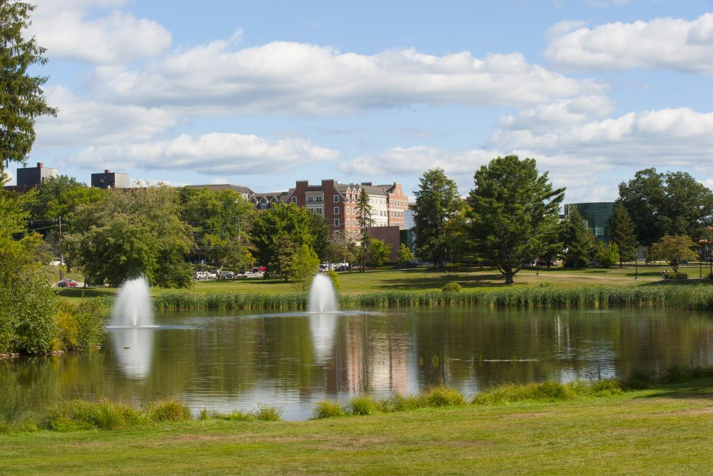 Mirror Lake on a summer day in 2014, with Storrs Center in the background. (Sean Flynn/UConn Photo)