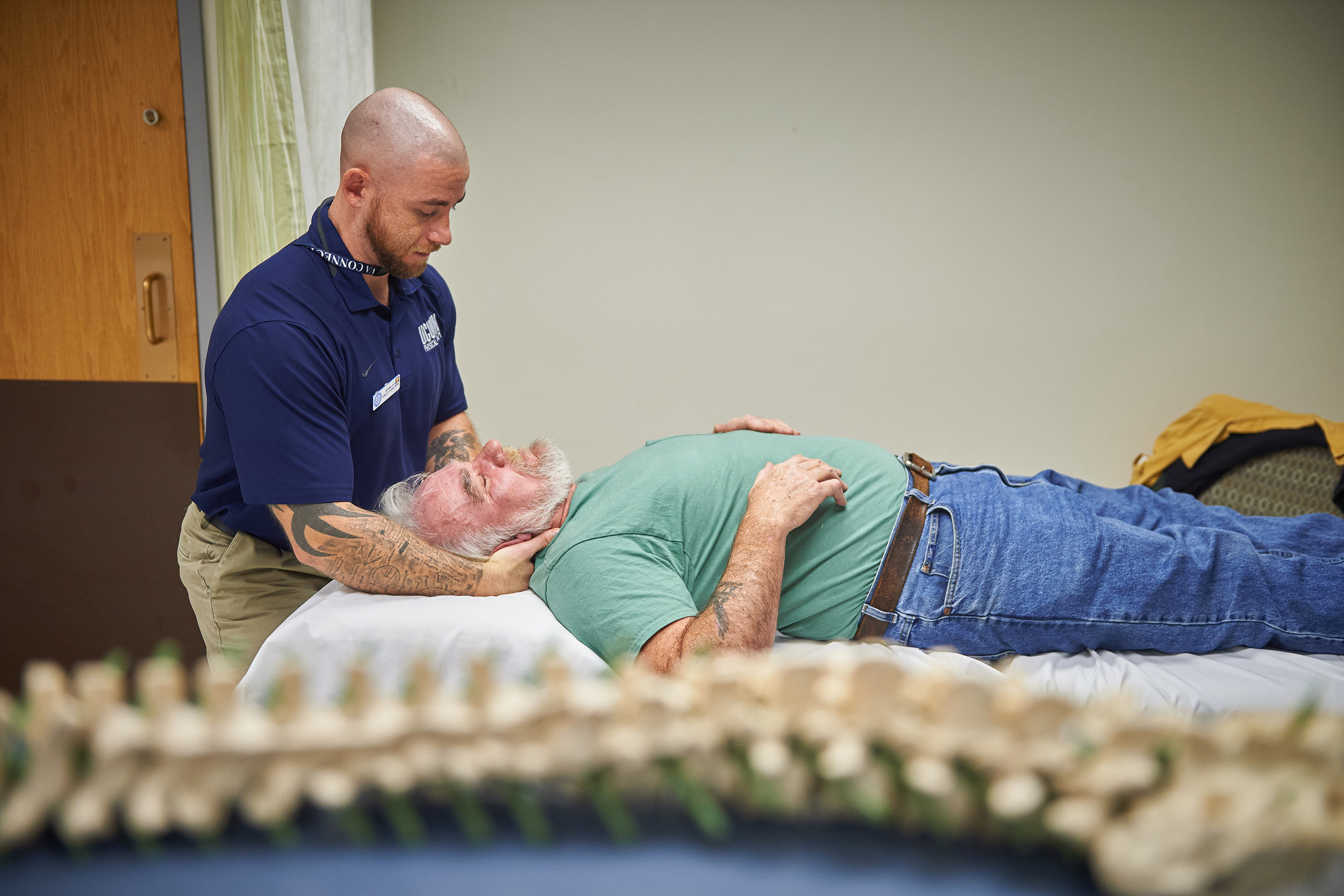 Nathaniel Hutt, a doctor of physical therapy student, works with a patient in the Outpatient Rehab Clinic at the VA Hospital in West Haven. (Peter Morenus/UConn Photo)