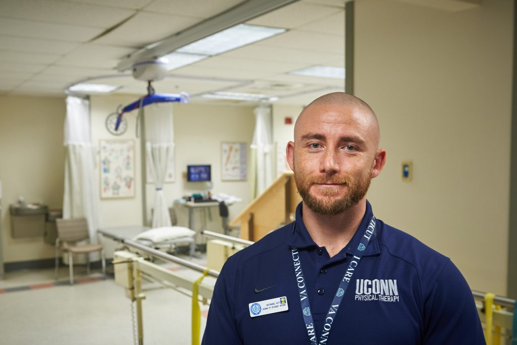 Nathaniel Hutt, a doctoral student of kinesiology, at the Outpatient Rehab Clinic at the VA Hospital in West Haven on Nov. 9, 2016. (Peter Morenus/UConn Photo)