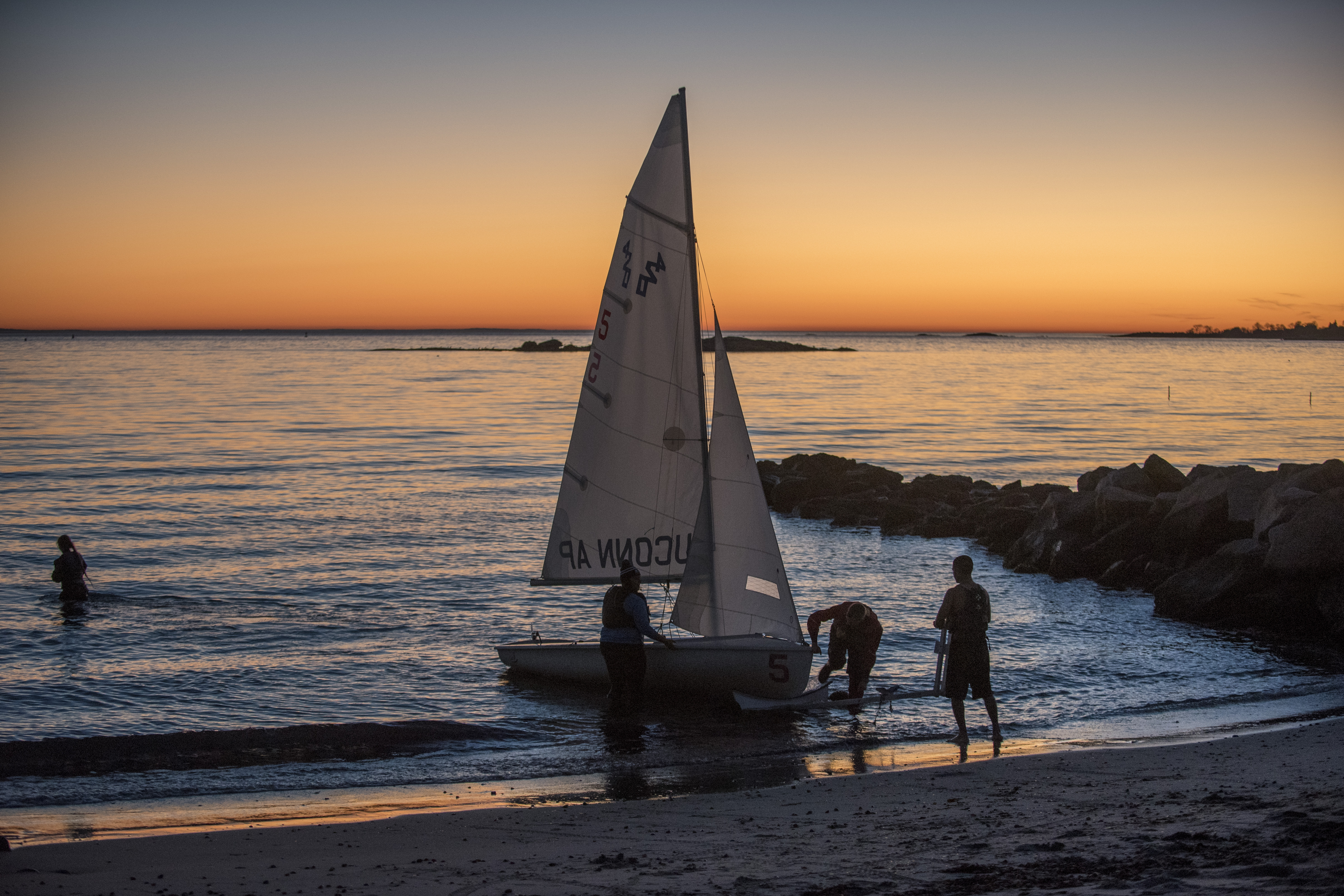The UConn sailing club sailing in Long Island Sound as the sun sets at the Avery Point campus on Nov. 18, 2016. (Sean Flynn/UConn Photo)