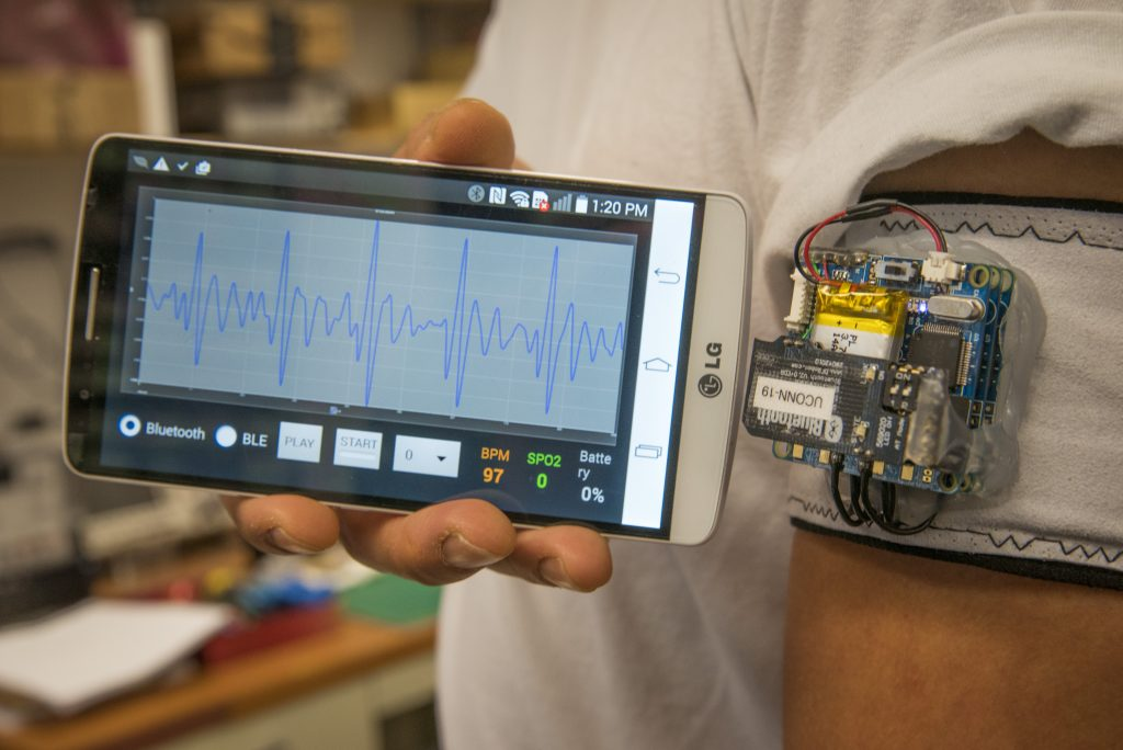 A heart monitoring device that detects irregular heart beat algorithms, using sensors attached to an armband and a phone app. (Sean Flynn/UConn Photo)