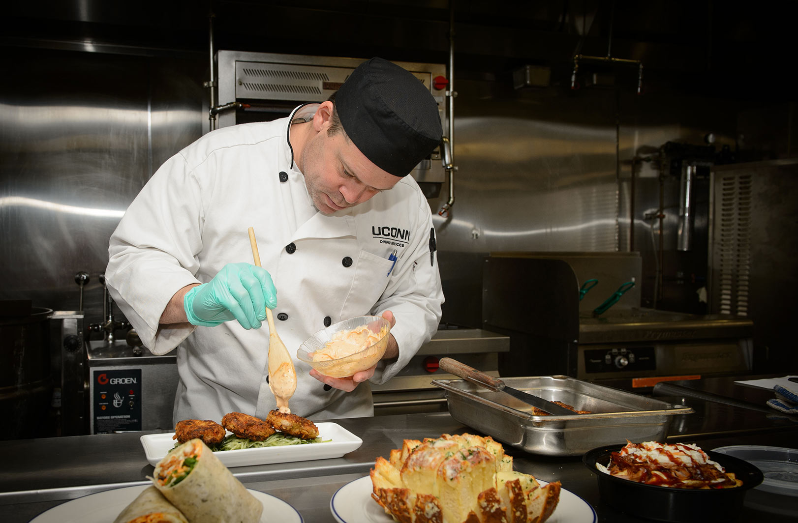 Rob Landolphi prepares vegan crab cakes at the Dining Services test kitchen in the Student Union.