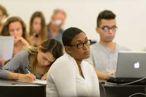 Students listen during a lecture at the Stamford campus on Oct. 19, 2016. (Peter Morenus/UConn Photo)
