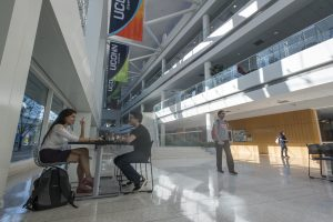 Students having a conversation in the atrium of UConn Stamford on Oct. 19, 2016. (Sean Flynn/UConn Photo)