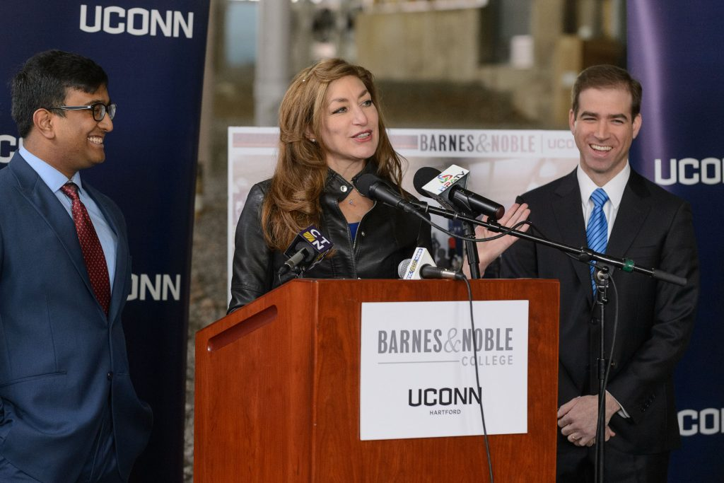 President Susan Herbst introduces UConn Hartford student body president Syed Naqvi, left, at a press conference held on Jan. 25, 2017 to announce the site selection for a new UConn Bookstore operated by Barnes & Nobleadjacent to the new UConn Hartford campus. At right is Mayor Luke Bronin. (Peter Morenus/UConn Photo)