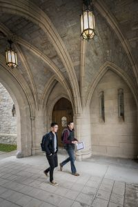 Walking through the arch at UConn School of Law. (Sean Flynn/UConn Photo)