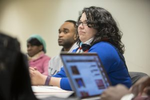 Dalié Jiménez listening to student presentations at UConn School of Law. (Sean Flynn/UConn Photo)