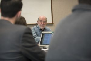 Listening to a lecture by Thomas Morawetz talking with students at UConn School of Law. (Sean Flynn/UConn Photo)