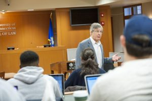 Listening to a lecture by Timothy Everett at the School of Law. (Sean Flynn/UConn Photo)