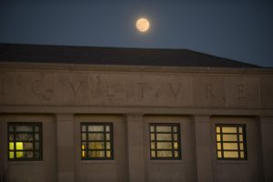 The moon over the Young Building on Dec. 12, 2016. (Sean Flynn/UConn Photo)