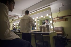 Troy Frey '19 (SFA), left, and Luke Powers '19 (SFA) in the dressing room at Jorgensen before the dress rehearsal of H.M.S. Pinafore on Jan. 24, 2017. (Sean Flynn/UConn Photo)