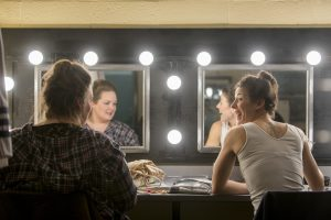 Judy Bowers DMA '17, left, and Caroline O'Dwyer '11 (SFA), '18 DMA in the dressing room at Jorgensen before the dress rehearsal of H.M.S. Pinafore on Jan. 24, 2017. (Sean Flynn/UConn Photo)